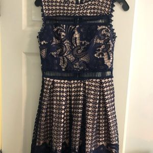 Navy lace cocktail dress with cutouts